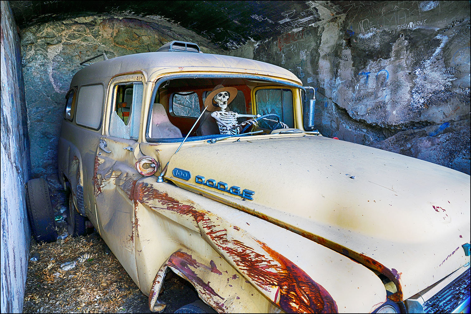 Dodge truck in cave with skeleton driver